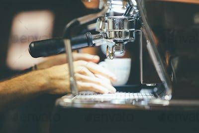 Bartender making coffee on coffee machine