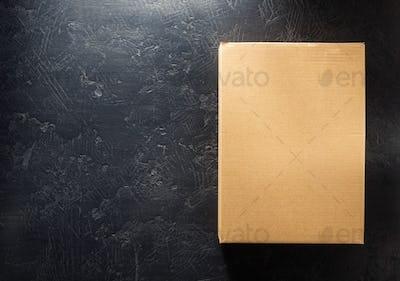 cardboard box on black background