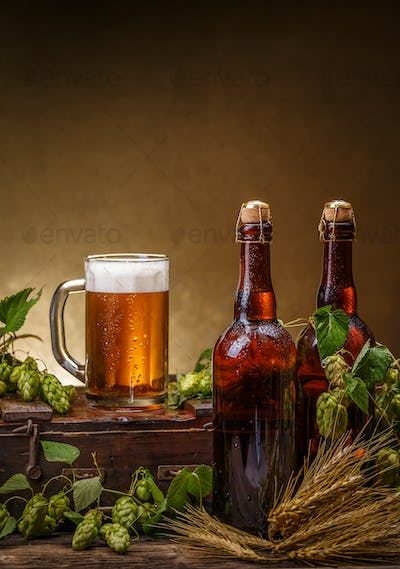 Glass and bottles of beer