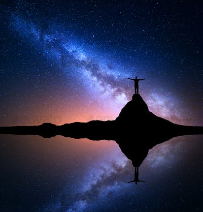Milky Way and man on the rock. Galaxy, Universe