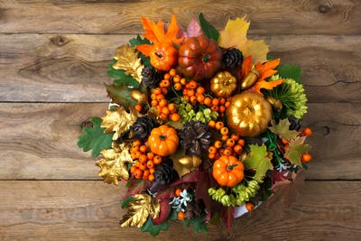 Thanksgiving wreath on the old wooden table