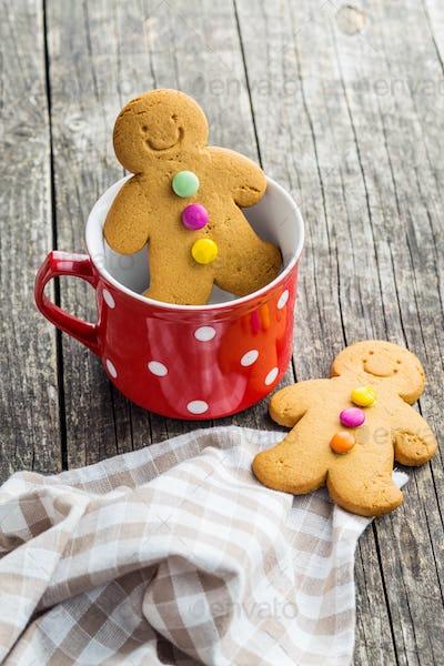 Gingerbread man in mug.