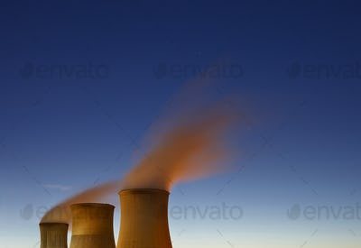 Three Steaming Cooling Towers At Night
