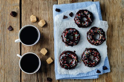Baked chocolate doughnuts with chocolate glaze