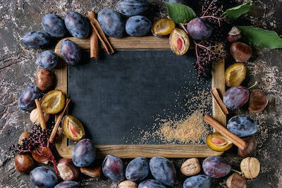 Plums and walnuts with chalkboard