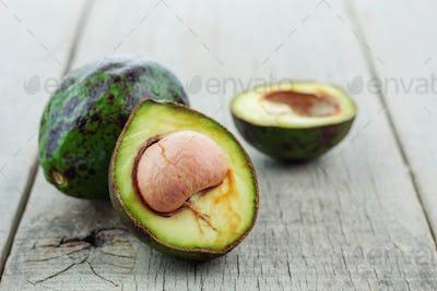 Half avocado on wooden