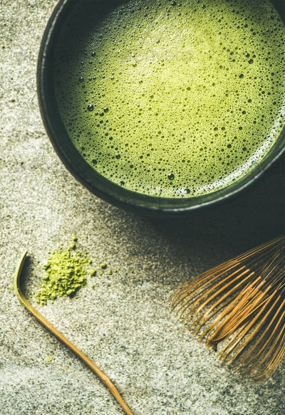 Flat-lay of freshly brewed Japanese matcha tea in Chasen bowl