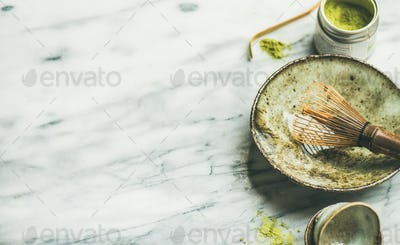 Japanese tools for brewing matcha tea, marble background, copy space