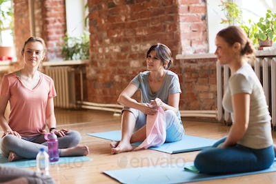 group of women resting on yoga mats at studio