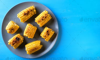 Gray plate with baked corn
