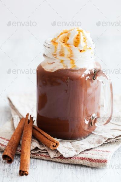 hot chocolate with whipped cream caramel in mason jar