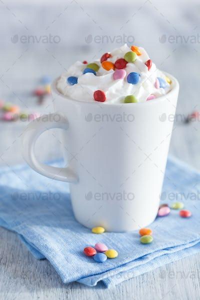 coffee with whipped cream and colorful chocolate drops