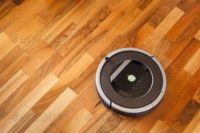 robotic vacuum cleaner on laminate wood floor smart cleaning tec