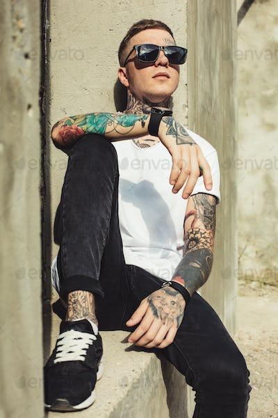Stylish man posing outside