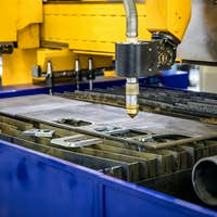CNC Laser plasma cutting of metal, modern industrial technology.