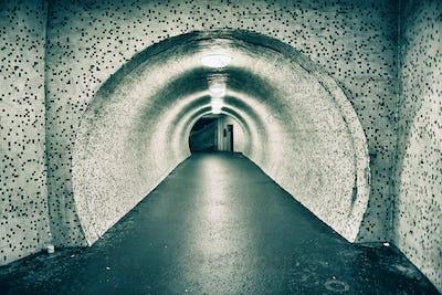 Abandoned old empty underground tunnel. Toned image
