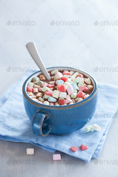 hot chocolate with marshmallow and red hearts