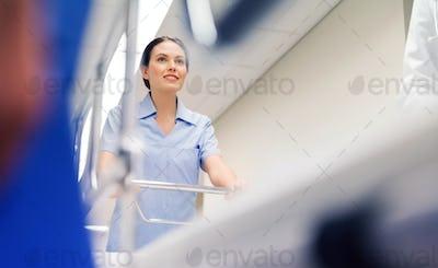 medic carrying hospital gurney at emergency