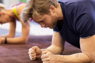 close up of man at training doing plank in gym