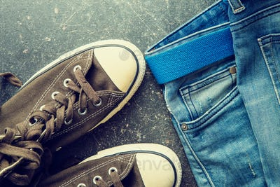Blue jeans and vintage sneakers.