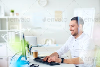 businessman typing on computer keyboard at office