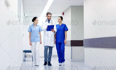 group of medics at hospital with clipboard