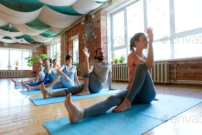 group of people doing yoga at studio