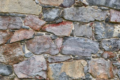 Rough stone wall facade. Textured background. Horizontal