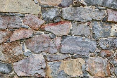 Rough stone wall facade. Textured background. Horizontal