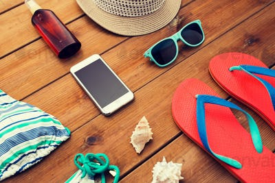 close up of smartphone and beach stuff