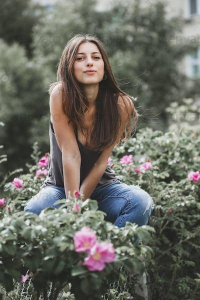 Girl posing against street