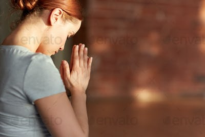 close up of woman meditating at yoga studio