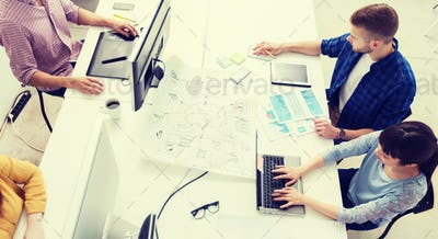 creative team with computers, blueprint at office