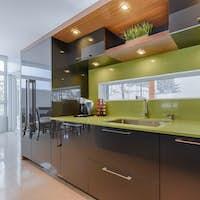 Modern kitchen with green quartz counter top close-up