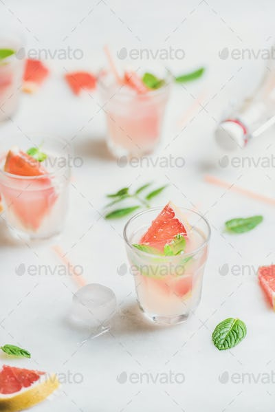 Cold refreshing summer alcohol cocktail with fresh grapefruit