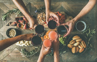 Flat-lay of friends eating and drinking together, top view