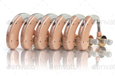 Hearing aids in a row isolated on white background. Deaf ear aid