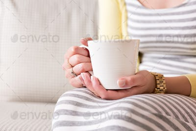 Female hands with cup