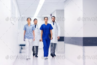 group of medics or doctors at hospital corridor
