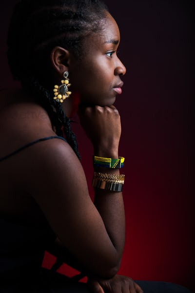 Woman Wearing Jewelry Over Red Background