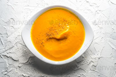 Homemade pumpkin soup in a white plate