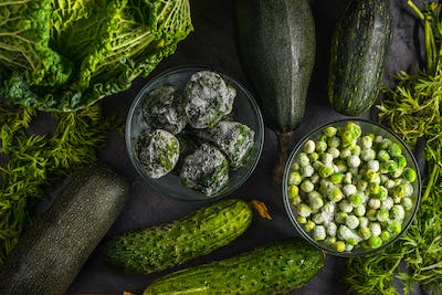 Background of green vegetables of cucumbers, Savoy cabbage