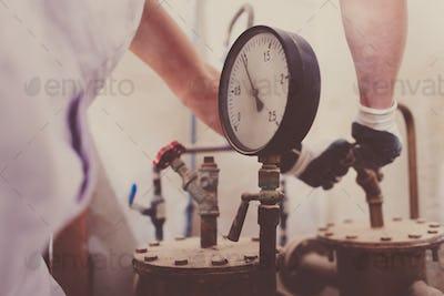 Plumber Works Meter Closeup