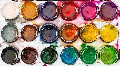 Used children's honey watercolor paints . Top view.
