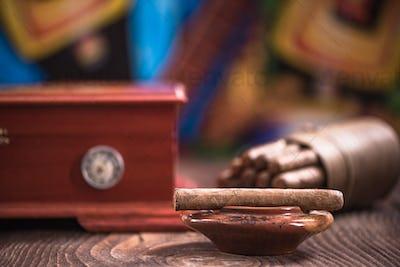 Wooden humidor, cigars and ashtray