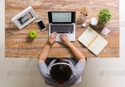 woman with receipt on laptop screen at office