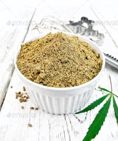 Flour hemp in bowl with leaf on light board
