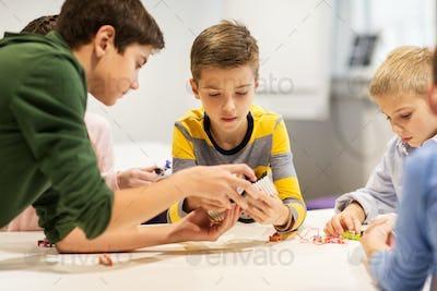 happy children building robots at robotics school