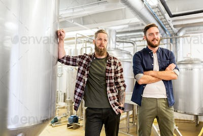 men at craft brewery or beer plant