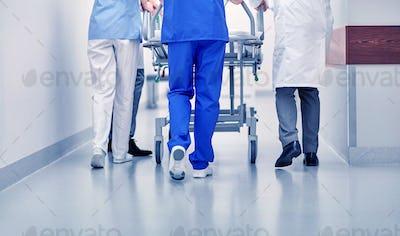 medics carrying hospital gurney to emergency room